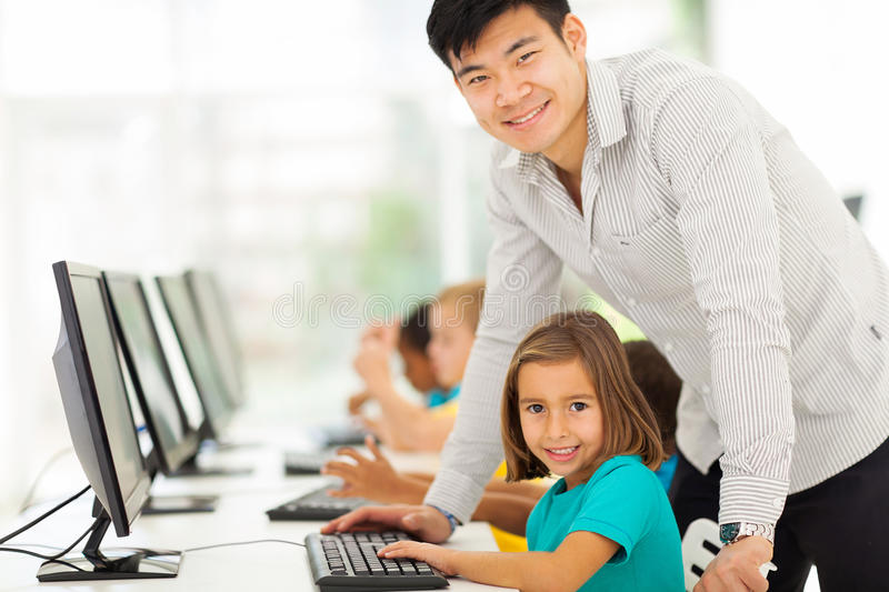 Computer teacher students stock images