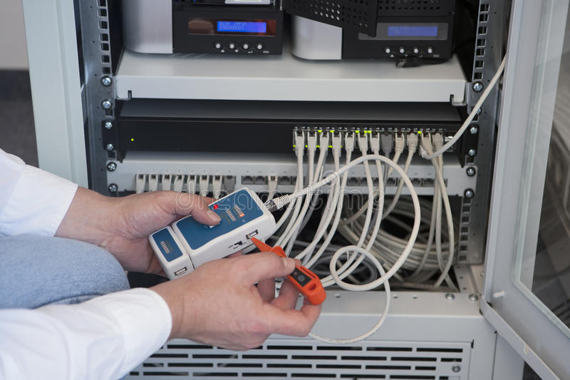 Computer technician. With a tester for a network