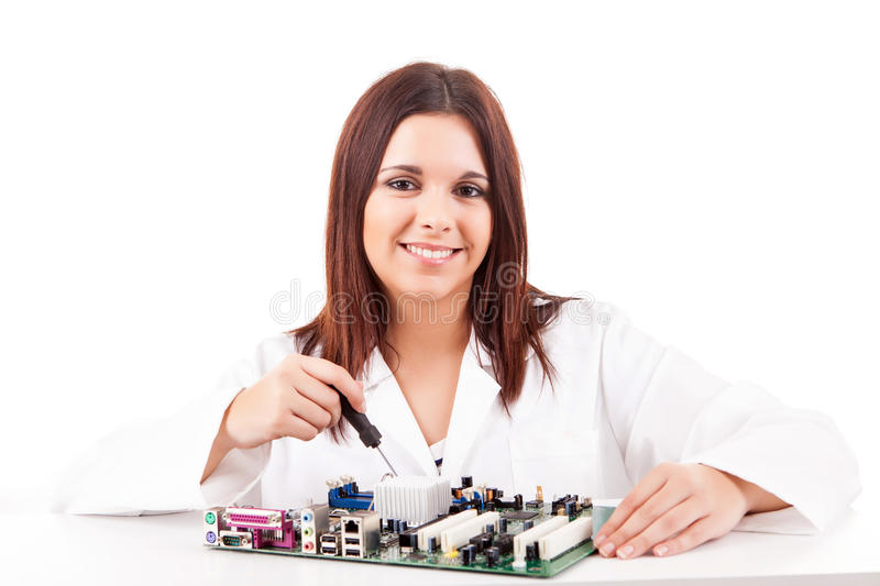Computer technician. Happy and successful young computer technician royalty free stock image
