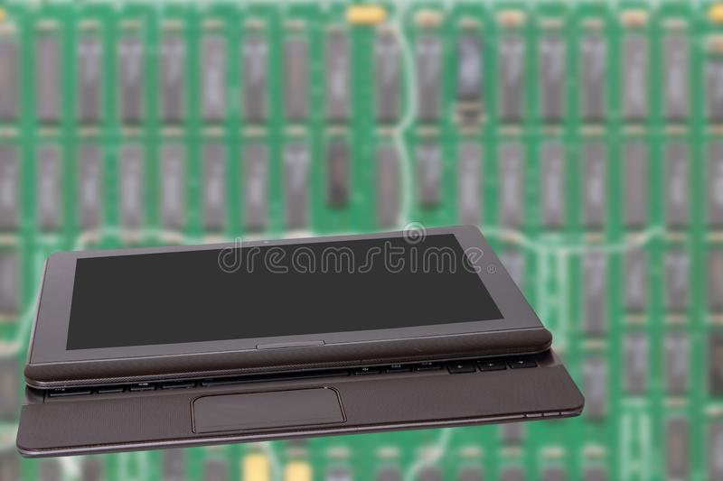 Computer technology background. Close up of modern portable laptop with a dark or black blank screen in front of bright blurred royalty free stock photography