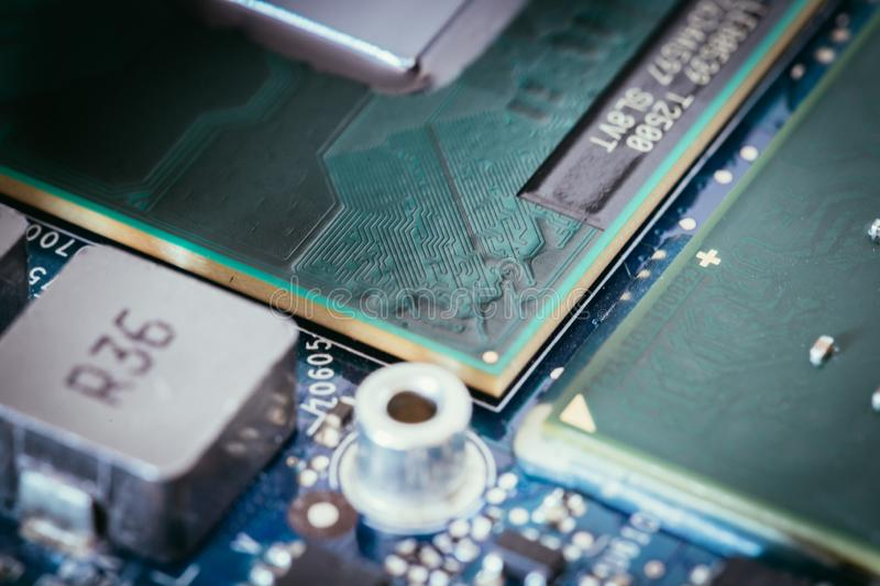 Computer Technology: Close up of a computer chip on a circuit board. Computer chip on a circuit board, close up; Computer technology artificial intelligence big stock image