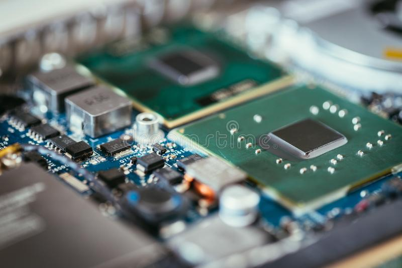 Computer Technology: Close up of a computer chip on a circuit board. Computer chip on a circuit board, close up; Computer technology artificial intelligence big stock images