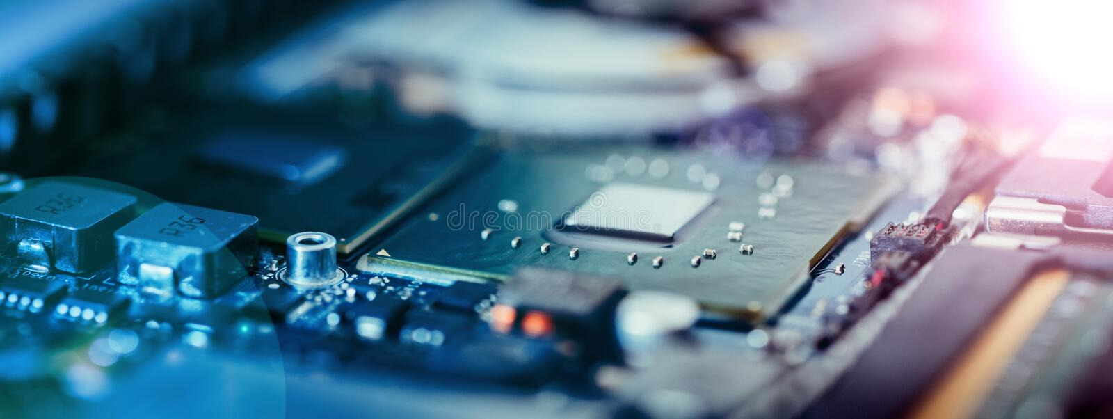Computer Technology: Close up of a computer chip on a circuit board. Light effect. Computer chip on a circuit board, close up with light effect. Computer royalty free stock photos