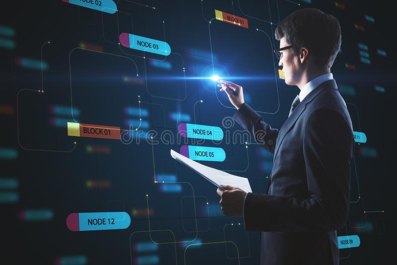 Computer technology concept with businessman touching digital screen with node tree royalty free stock photography