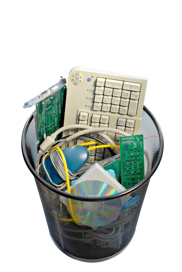 Computer Trash. A waste basket of used computer parts ready for the trash. File has clipping path