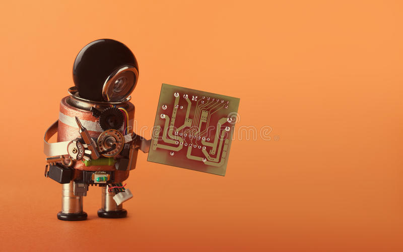 Computer upgrade automation concept. Robot with abstract circuit chip. retro style toy cyborg, black helmet head stock photo