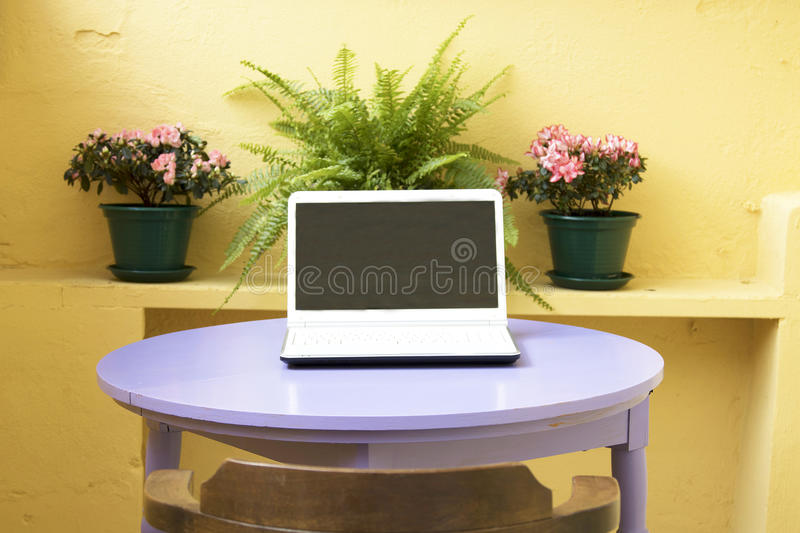 Computer in the urban terrace royalty free stock photos