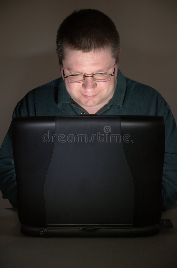 Free Computer User In Darkened Room Stock Photography - 4831522