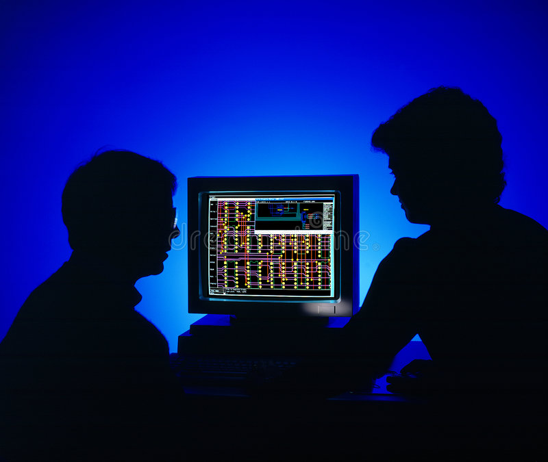 Computer viewers. Two people viewing a computer screen backlit on a gradated blue background