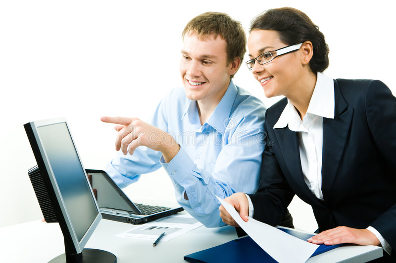 Computer work. Portrait of confident businessman pointing at computer talking about work with woman near by