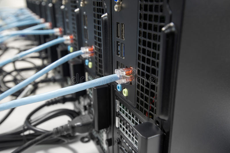 Computers connected to the network. Computers standing in a row and connected to the local network royalty free stock photo
