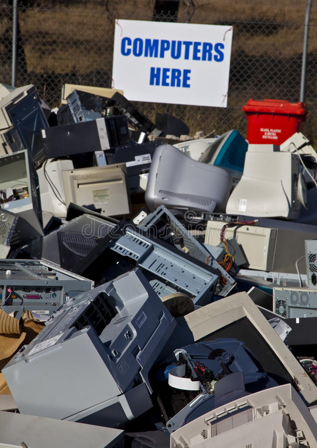 Computers and monitors piled up for recycling royalty free stock image