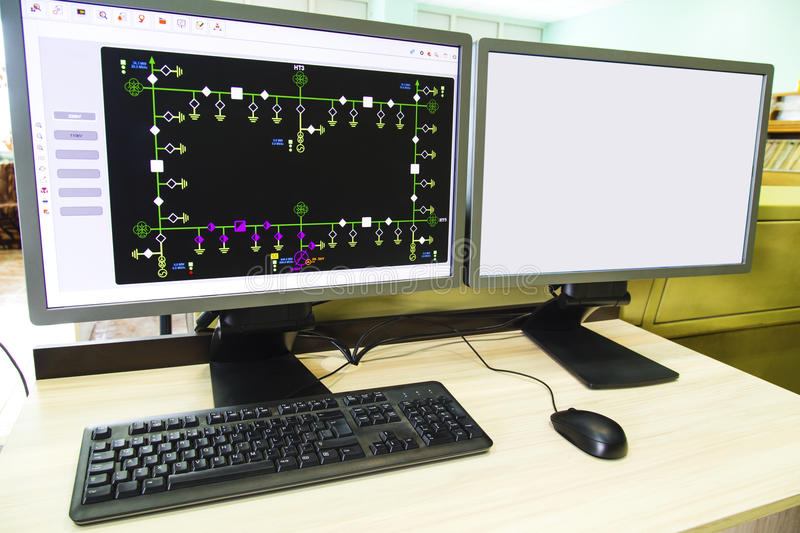Computers and monitors with schematic diagram for supervisory, control and data acquisition stock photography