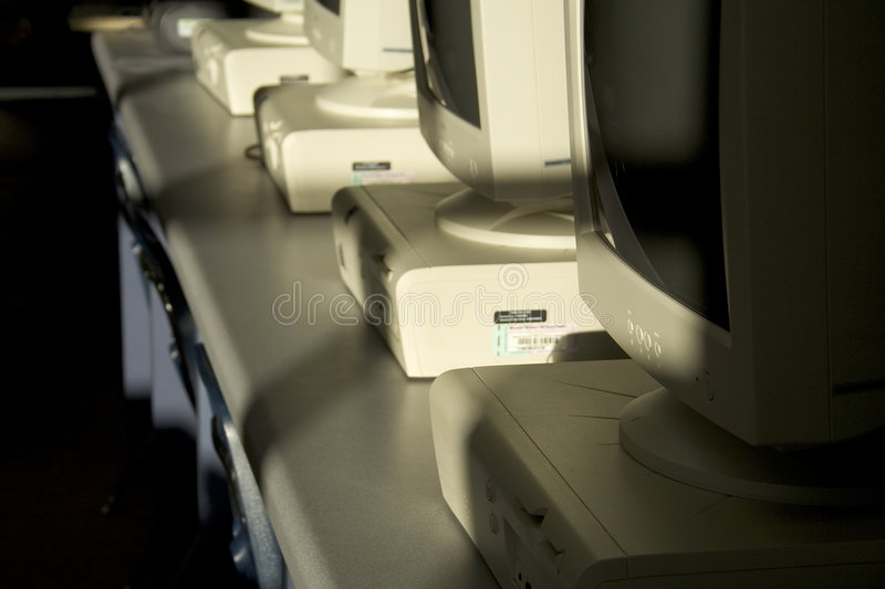 Computers in a row from side. stock image