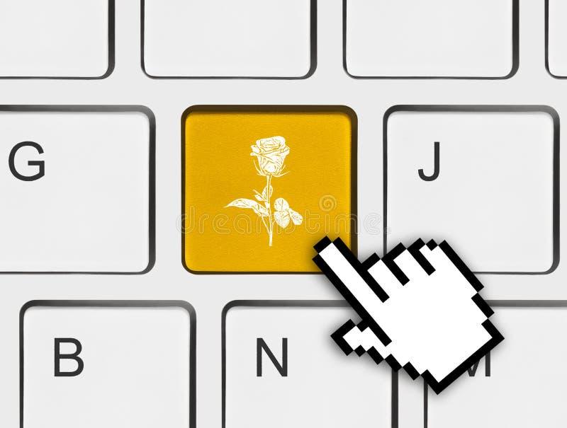 Computertoetsenbord met bloemsleutel royalty-vrije stock afbeeldingen