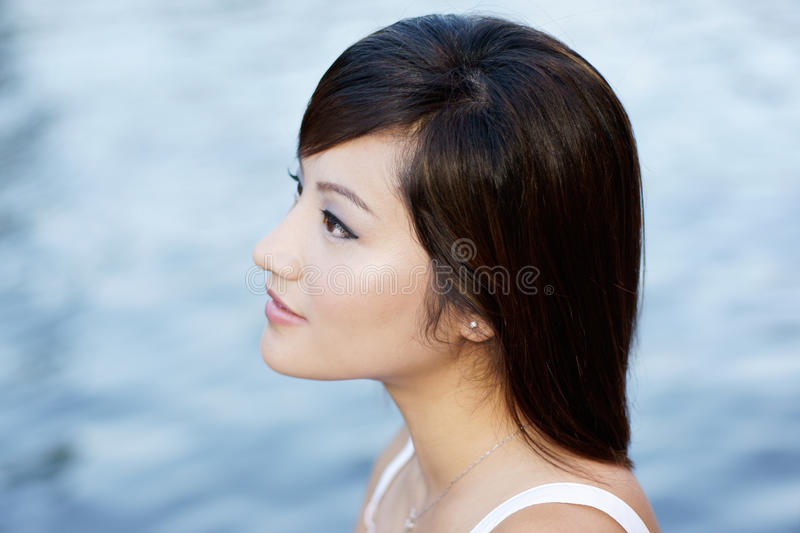 Comtemplative Chinese Attractive Girl By Waters Royalty Free Stock Images