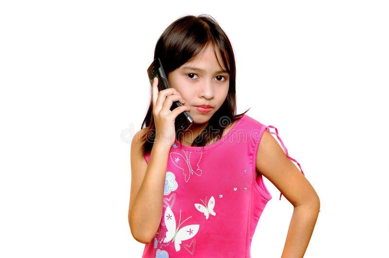 Comunicando con telefono fotografia stock