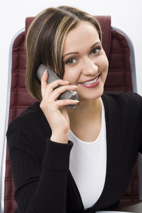 Comunicando dal telefono immagini stock