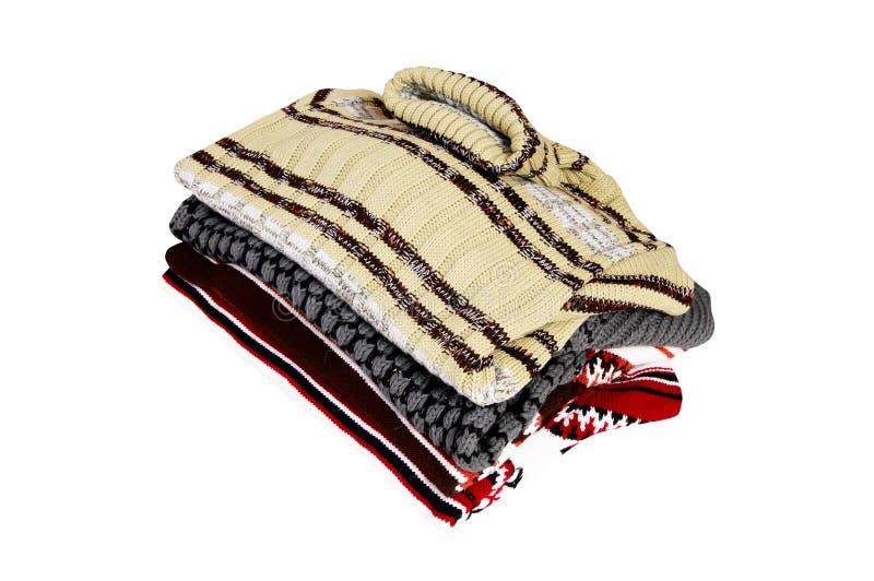 Con estilo, caliente, suéteres del invierno en un blanco. imagen de archivo libre de regalías