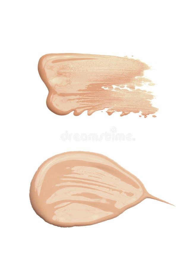 Concealer o la crema di tono ha sbavato di inchiostro immagine stock