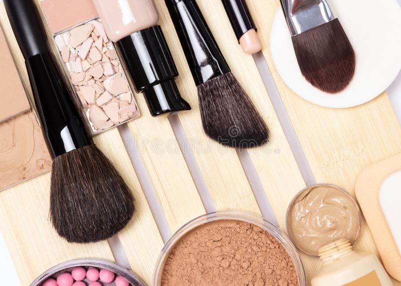 Concealer, primer, foundation, powder, blush with make-up brush. Make-up products for perfect complexion: concealer, primer, foundation, powder, blush with royalty free stock images