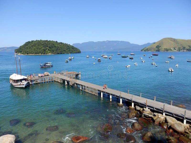 Conceicao de Jacarei bay in Rio de Janeiro State. Green coast, tropical forest, boats stock images