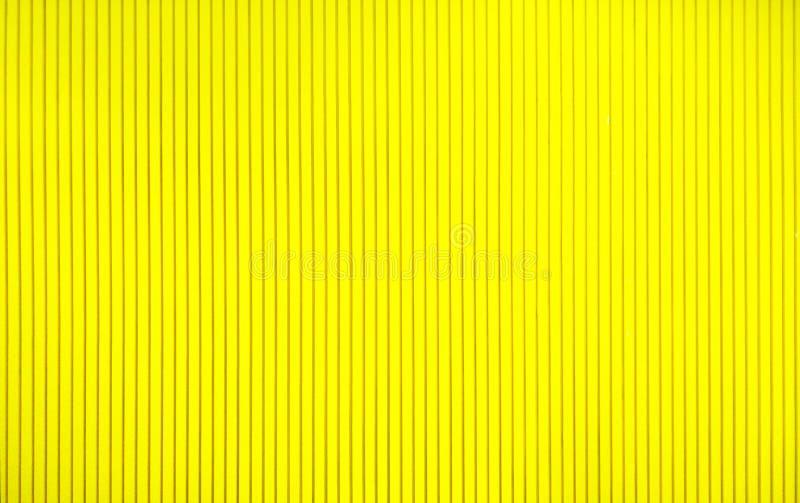 Conceito abstrato do fundo, fim acima da parede bonita do amarelo da textura e projeto simples da linha reta para decorativo inte imagens de stock