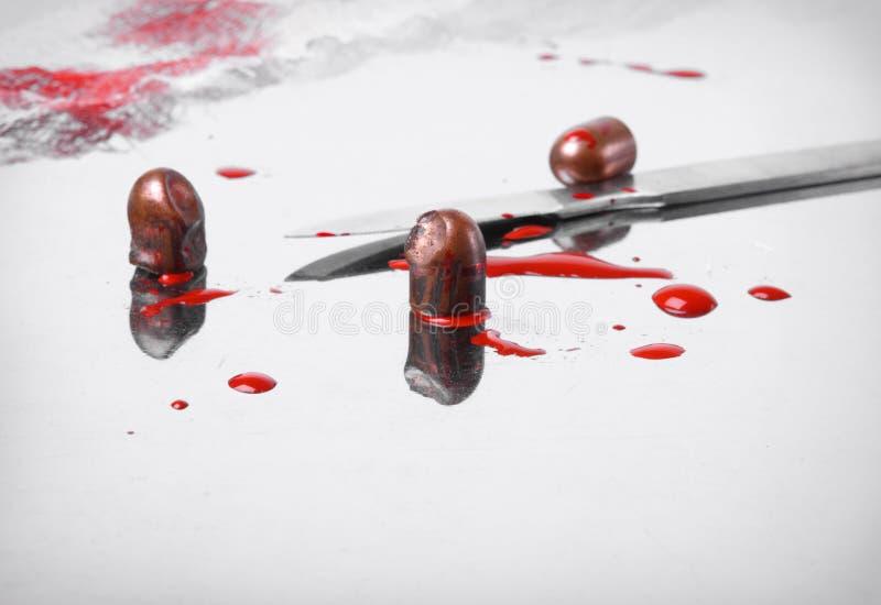 Conceito cirúrgico com balas e sangue fotografia de stock royalty free