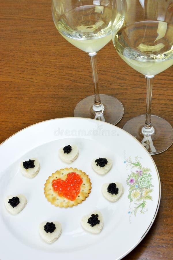 Conceito com o caviar preto e vermelho imagem de stock royalty free