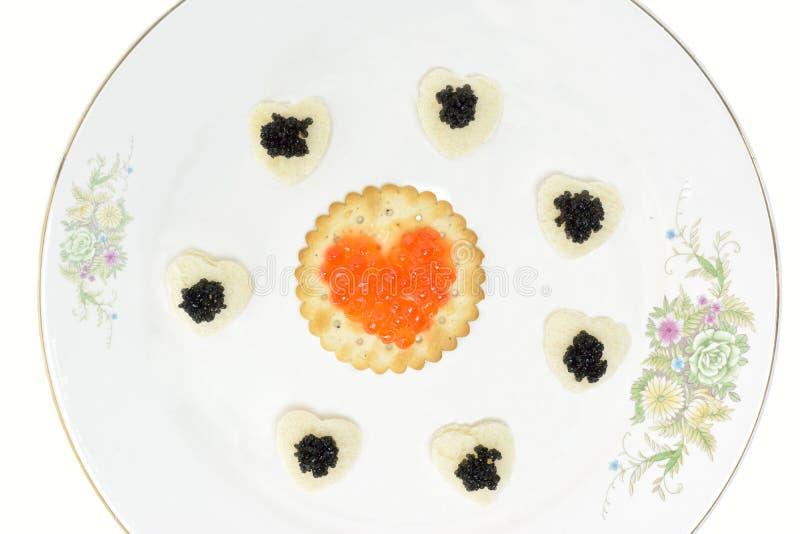 Conceito com o caviar preto e vermelho imagens de stock royalty free