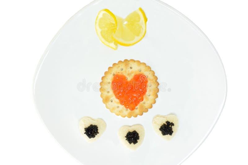 Conceito com o caviar preto e vermelho fotografia de stock royalty free