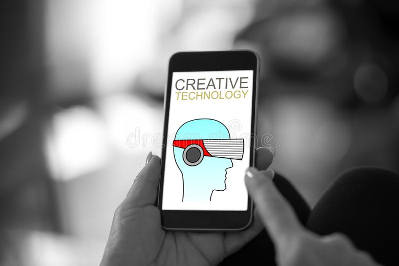 Conceito criativo da tecnologia em um smartphone fotografia de stock