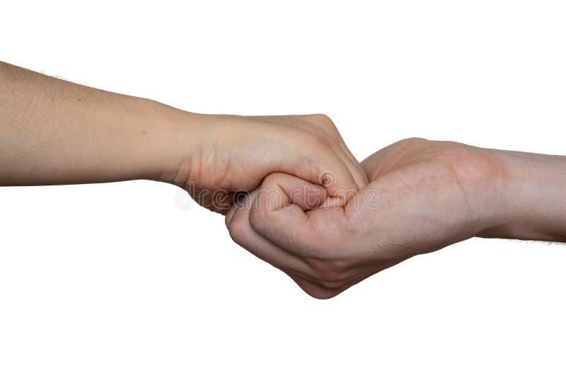 Conceito da ajuda e do apoio Duas mãos que mantêm-se unidas Isolado no fundo branco imagens de stock