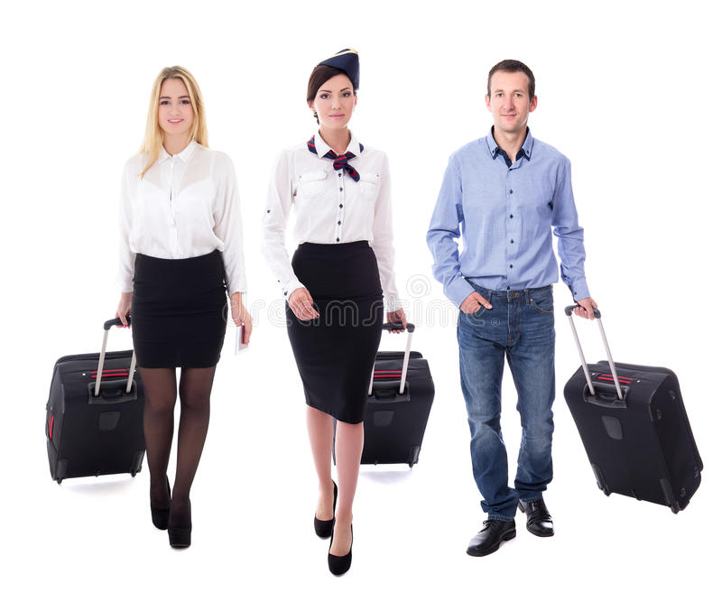 Conceito da aviação - wa atrativo novo da comissária de bordo e dos passageiros imagem de stock