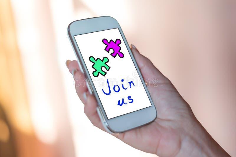 Conceito da cooperação em um smartphone imagem de stock