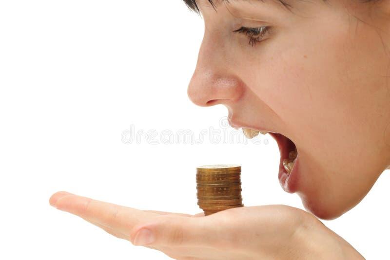 Conceito da crise - comendo seu dinheiro fotografia de stock