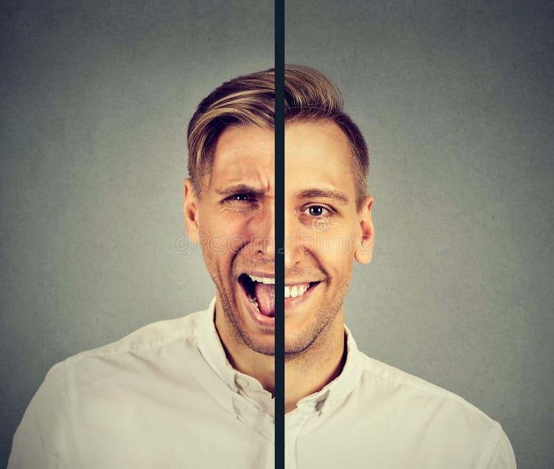 Conceito da doença bipolar Homem novo com expressão dobro da cara fotos de stock royalty free