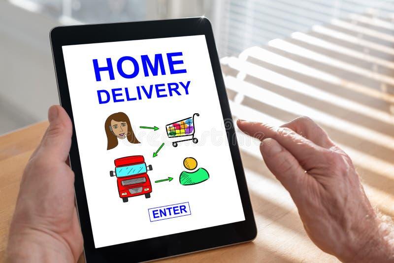 Conceito da entrega a domicílio em uma tabuleta imagens de stock royalty free