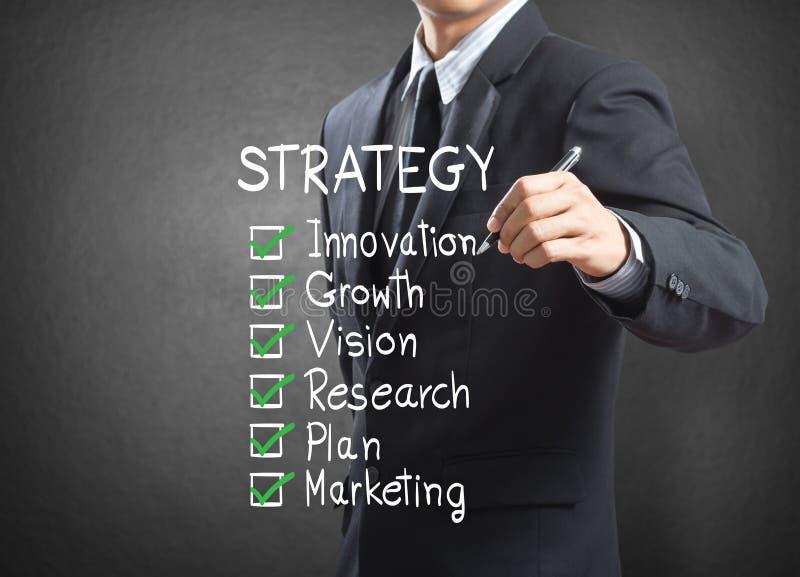 Conceito da estratégia da escrita do homem de negócios imagens de stock