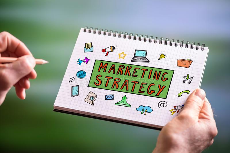 Conceito da estratégia de marketing em um bloco de notas fotografia de stock royalty free