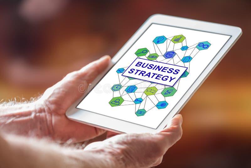 Conceito da estratégia empresarial em uma tabuleta fotos de stock royalty free