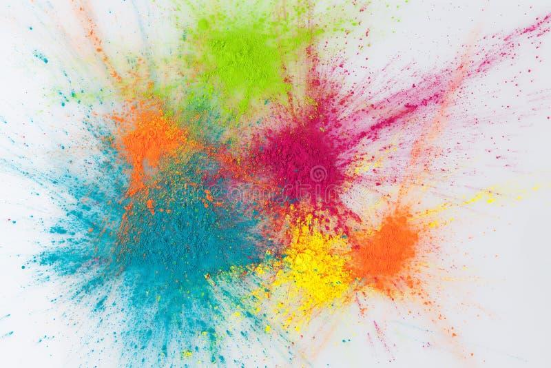 Conceito da explosão da cor com pó do holi fotografia de stock