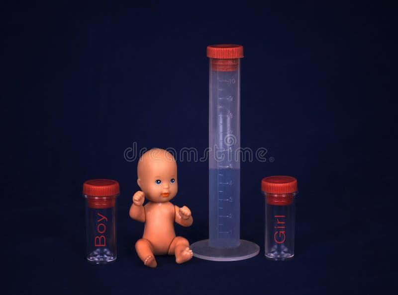 Conceito da fecundação de vitro - bebê e tubo de ensaio imagem de stock