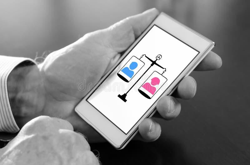 Conceito da igualdade em um smartphone imagem de stock