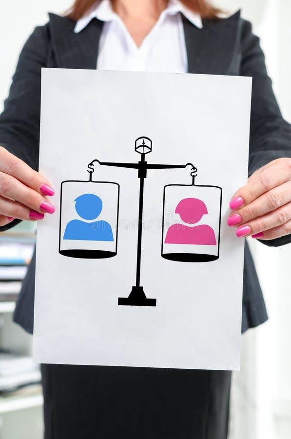 Conceito da igualdade mostrado por uma mulher de negócios imagem de stock