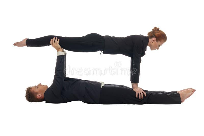 Conceito da multitarefa As acrobatas mantêm o equilíbrio fotografia de stock royalty free
