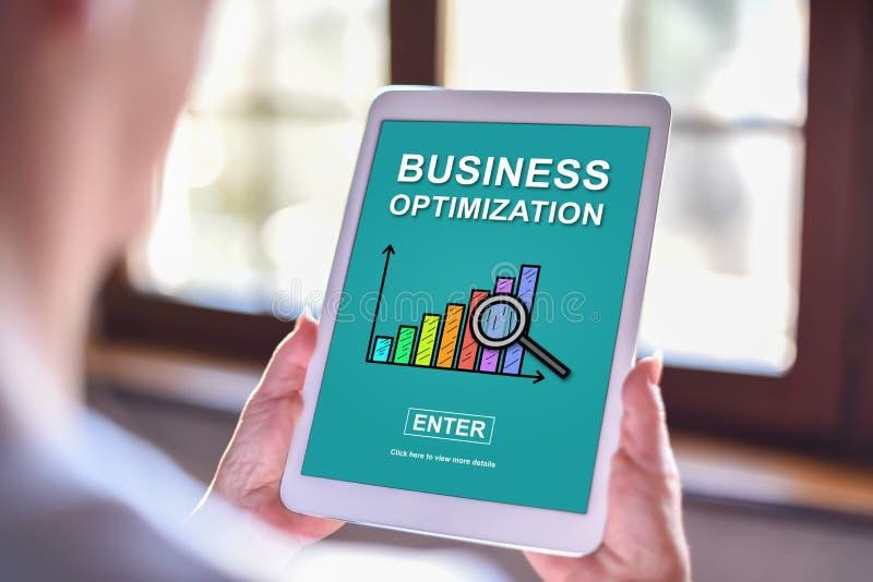 Conceito da otimização do negócio em uma tabuleta imagem de stock royalty free