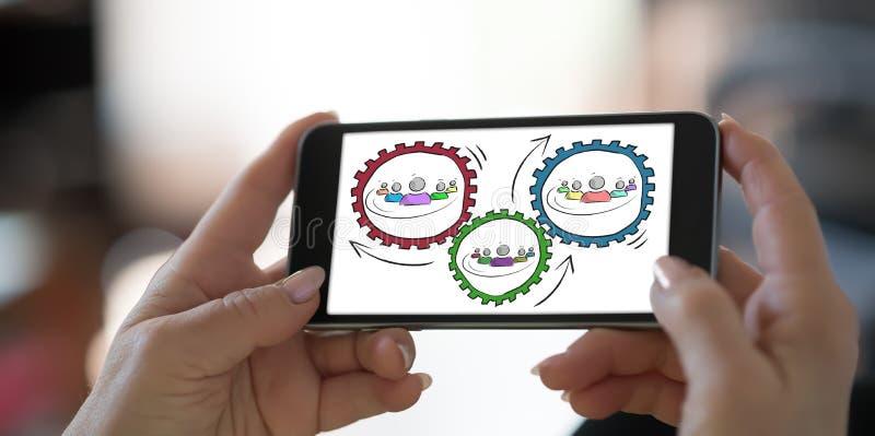 Conceito da parceria em um smartphone imagens de stock