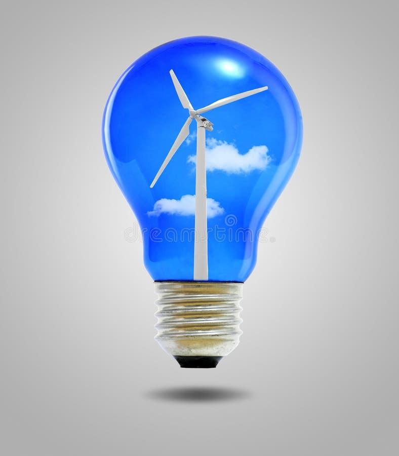Conceito das energias eólicas, ampolas com turbina eólica imagens de stock royalty free