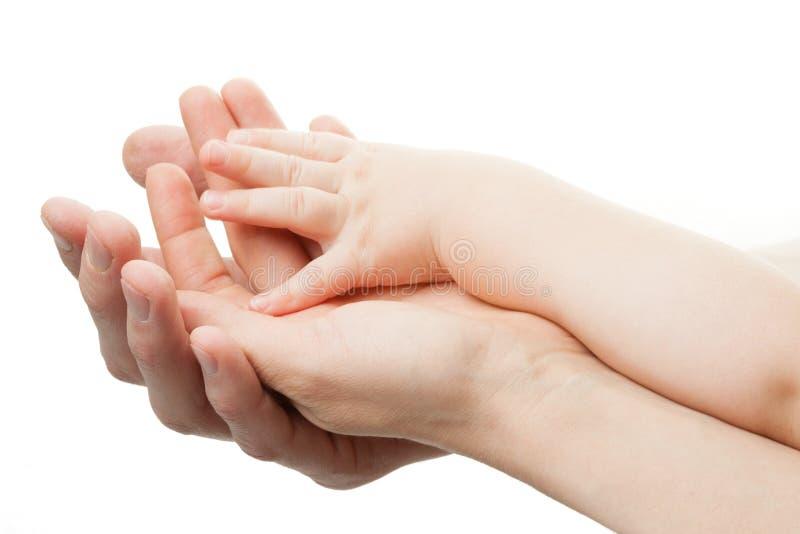 Conceito de família. Três mãos da família no branco imagem de stock royalty free